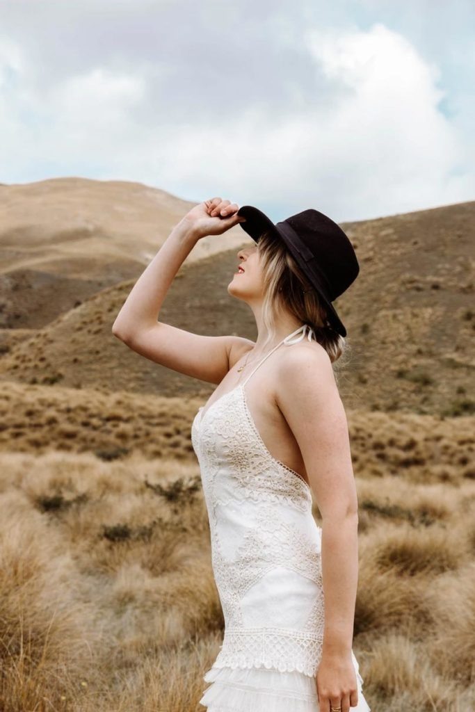 Bride in Hat with Tussocks