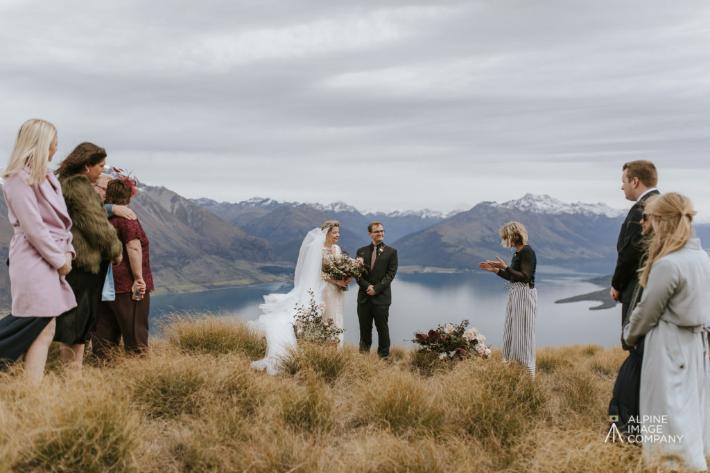 Marriage celebrant conducting marriage ceremony on mountain top in Queenstown New Zealand