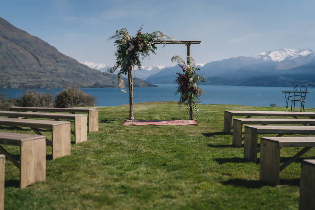 Floral Wedding Arch and Wooden Benches